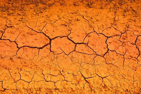 Cracked Earth ,Abstract Texture Of Red-hot Cracked as texture and background Stock Photo