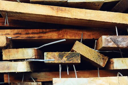 wood pile with protruding nails,Lumber on the shelf,Wood Orderly arrangement texture background