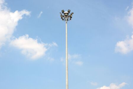 The big and high spot light with blue sky as background