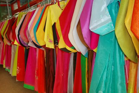 Lots of Colorful Hanbok hang on the wall, traditional dress of South Korea