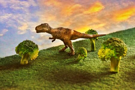 Tyrannosaurus rex or t-rex infront colorful sky and foliage in background