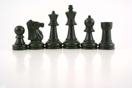 an image of black chess pieces Stock Photo