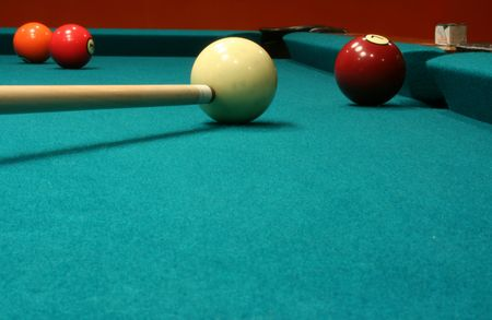 cue stick: An image of some billiard balls with a cue stick