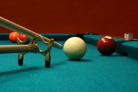 An image of some billiard balls with a cue stick and bridge