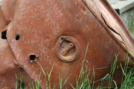 oxidized: an image of a Rusty 50 gallon Drum with bullet holes