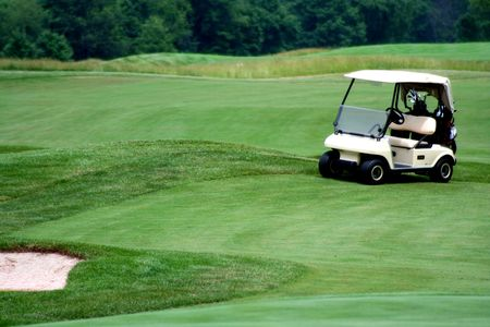 an image of a Golf cart on golf course Stock Photo
