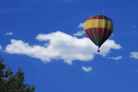 an image of a Hot air balloon and clouds photo