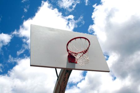 an image of a Basketball hoop against a cloudy sky Stock Photo