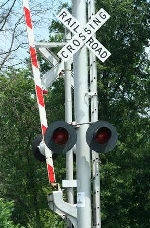 railroad crossing: Railroad crossing sign  with light with trees Stock Photo