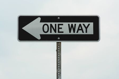 One way sign against cloudy sky Stock Photo - 1439321