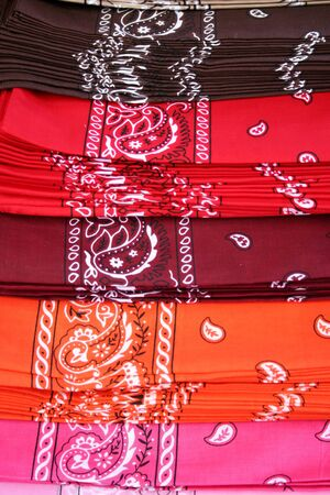 Different colored Bandanas layed out for sale Banco de Imagens