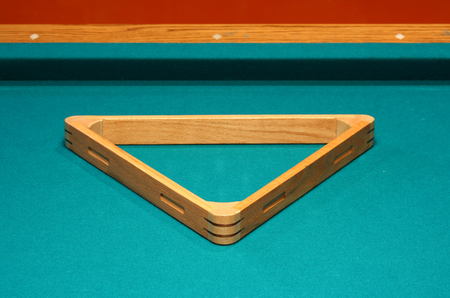 Empty 8 ball rack on a pool table