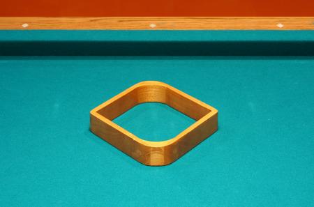 9 ball: Empty 9 ball rack on a pool table