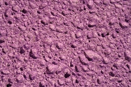 sink hole: close up of a purple sponge