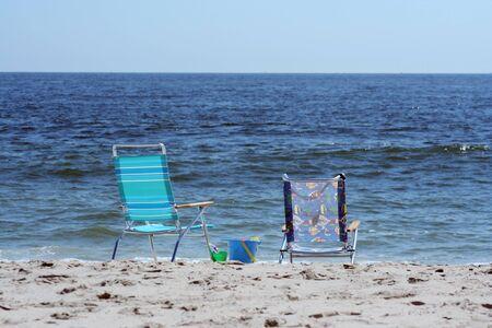 beachcomb: Beach Chairs near the ocean with bucket