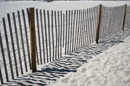 beachcomb: A wooden Fence on the beach