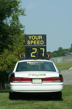 A Police Car Speed Check against blue sky