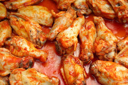 and chicken wings: Chicken Wings Cooking covered in sause