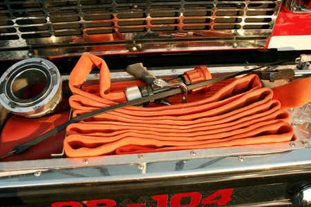 Fire Hoses on the front of a fire truck Stock Photo