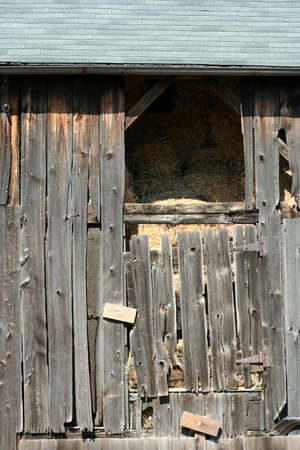 An Old wooden barn with bails of hay