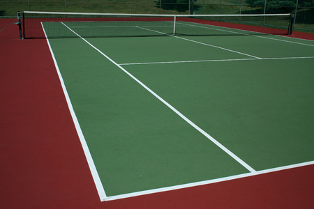 A empty green Tennis Court with net Stock Photo