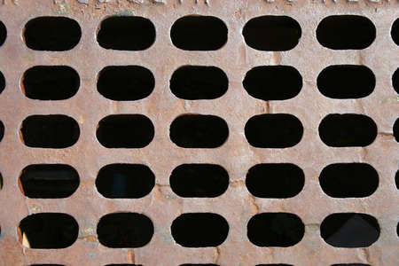 grate: a close up of a Sewer grate