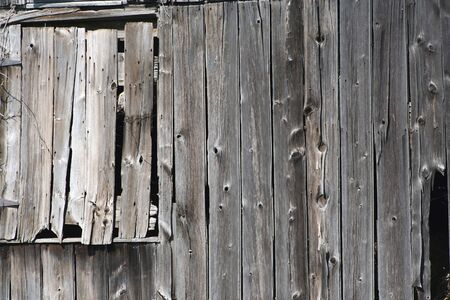 An Old wooden barn with a closed window Imagens
