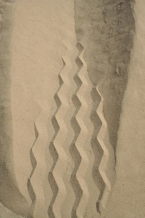 A Tire Track in the white sand Stock Photo - 1746896