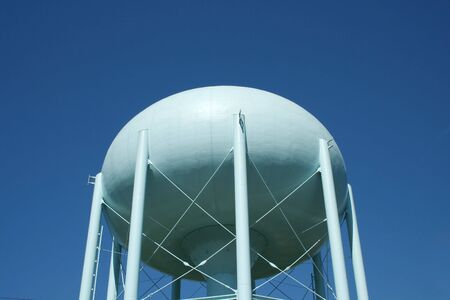 Blue Water Tower against a blue sky