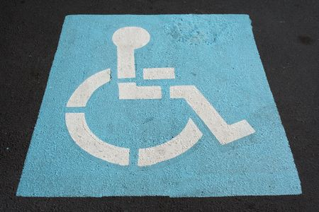 A Handicapped sign painted in a parking spot photo