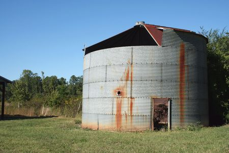 storage bin: Rusty old Crop Storage bin with blue sky
