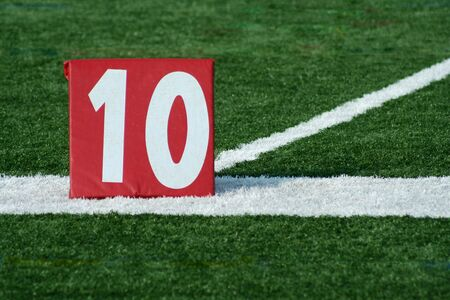 yardline: A red Football ten yard marker  Stock Photo