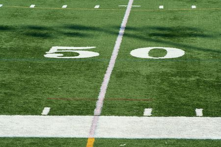 yardline: A white Football fifty yard marker  Stock Photo
