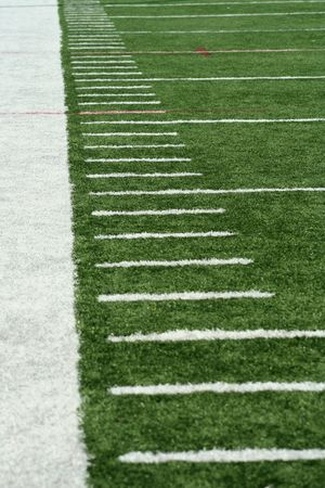 sideline: White Football Yard Markers on astro turf Stock Photo