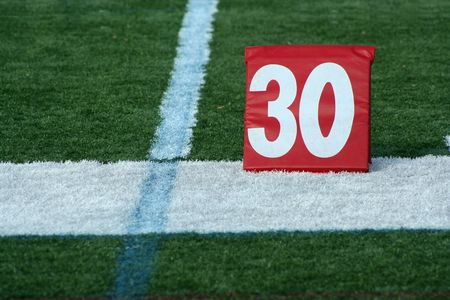 yardline: A red Football thirty yard marker  Stock Photo