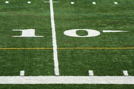 yardline: A white Football ten yard marker  Stock Photo