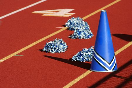 Cheerleader pom poms and megaphone at a football game photo