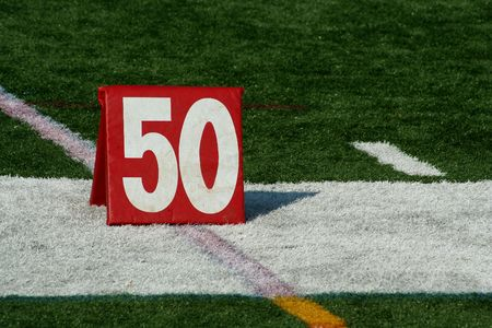 yardline: A red Football fifty yard marker  Stock Photo