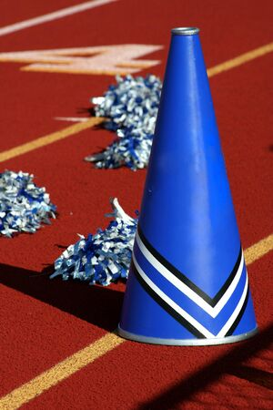 Cheerleader pom poms and megaphone at a football game Stock Photo - 1897124
