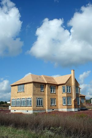 A New House being constructed under a blue sky Stock Photo - 1908173