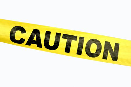 Yellow Caution Tape against a white background Stock Photo - 1921529