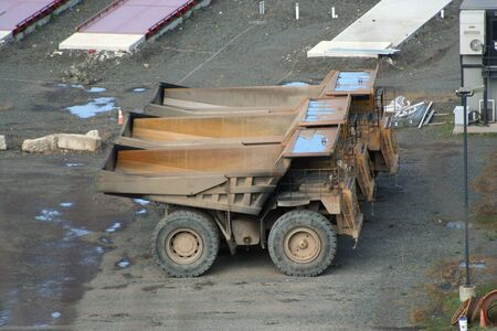 Three large quarry truck in a row photo