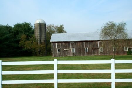 A Barn and silo with a white fence Stock Photo - 1952855