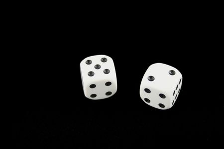 Seven and boxcars dice isolated on black background