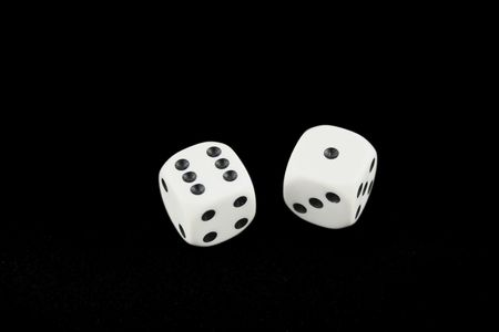 Seven and seven dice isolated on black background
