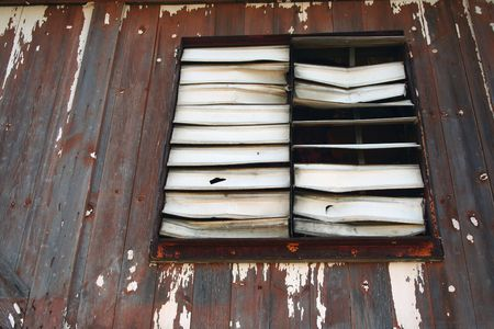 louvered: An old Old broken louvered Window  Stock Photo