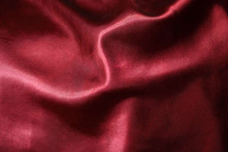 Flowing Red Silk textured Background Stock Photo