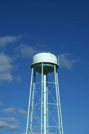 the water tower: Blue water Tower against blue sky