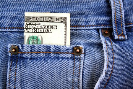 A One hundred dollar bill in jeans pocket photo