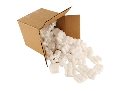 Isolated open cardboard box with spilled packing peanuts